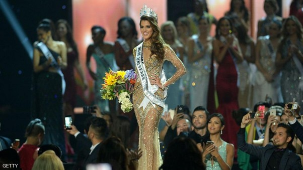 Iris Mittenaere of France poses on stage after being crowned the winner of the Miss Universe pageant at the Mall of Asia Arena in Manila on January 30, 2017. France was crowed Miss Universe on January 30 in a glitzy spectacle free of last year's dramatic mix-up but with a dash of political controversy as finalists touched on migration and other hot-button global issues. / AFP / TED ALJIBE (Photo credit should read TED ALJIBE/AFP/Getty Images)